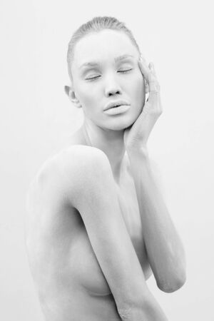 beautiful naked woman in white paint. beautiful nude girl black and white portrait