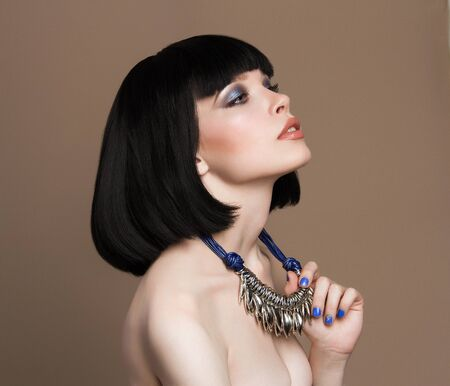 Beautiful girl with Bob Hairstyle and make-up. Naked beauty young woman