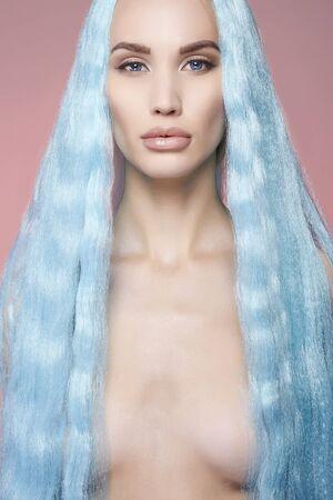 Beautiful naked girl with Long Blue Hair. Fairy beauty young woman. beautiful mermaid