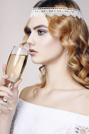 beautiful girl with glass of champagne at party. Elegant fashion glamour young lady