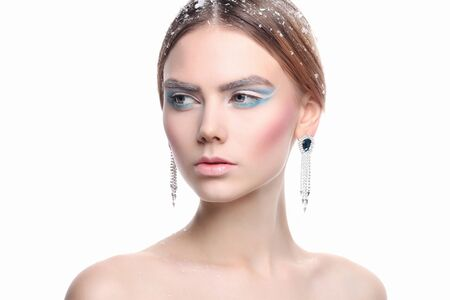 fashion beauty portrait of young woman with make-up and snow on her hair. beautiful model girl Stock Photo