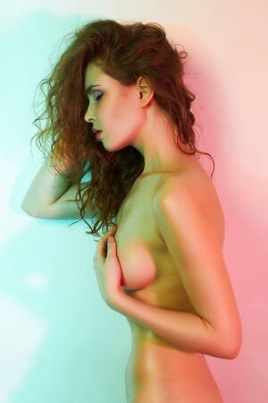beautiful naked girl in color lights. Nude body young woman art portrait Stock Photo - 149831441