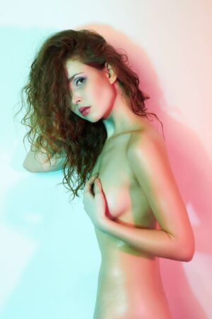 beautiful naked girl in color lights. Nude body young woman art portrait