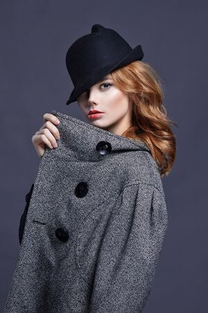 Beautiful red hair woman in hat. amazing girl with make-up. beauty fashion portrait
