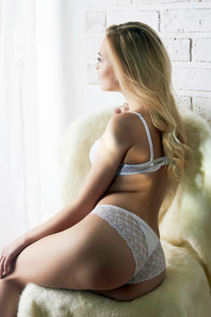 naked blonde girl. beautiful nude female body. sexy underwear. body part of naked woman Stock Photo
