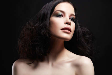 Beautiful girl with curly Hairstyle and make-up. Naked beauty sensual young woman Stock Photo