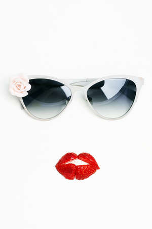 abstract still life. sunglasses and strawberries like a lips on female face