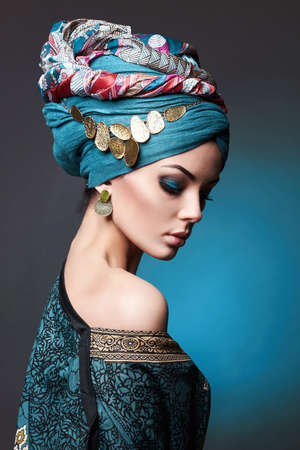 beautiful young woman in turban and jewelry. asian beauty girl. fashion oriental style woman