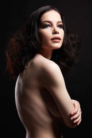 Beautiful girl with curly Hairstyle and make-up. Naked beauty sensual young woman Stockfoto
