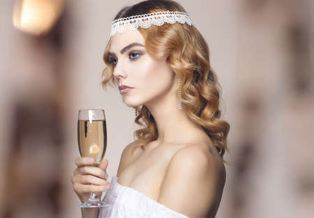 beautiful girl with glass of champagne at party. Elegant fashion glamor young lady Stockfoto