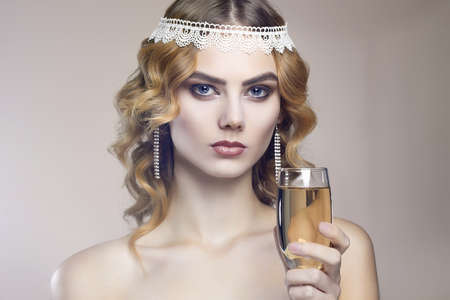 beautiful girl with glass of champagne at party. Elegant fashion glamor young lady Stock Photo