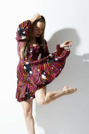 beautiful dancing girl in short dress. active young woman dancer