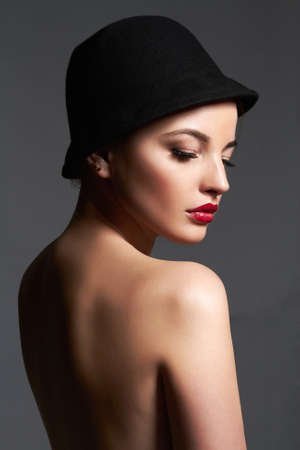 Beautiful woman in hat. nude body girl with make-up and Hat. beauty fashion portrait