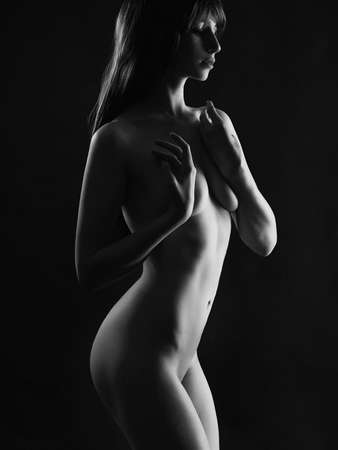 Black and white Female Nude Body. Naked Woman in the dark