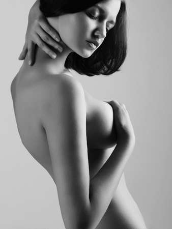 Black and white Female Nude Body. Naked Woman posing in studio
