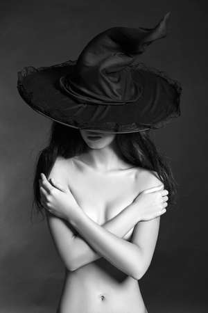 Witch woman in hat. blach and white halloween portrait