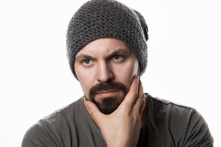Isolated portrait of handsome Bearded Man in Hat. Brutal hipster boy Reklamní fotografie