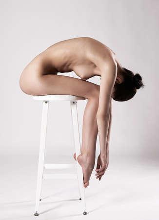 beautiful naked girl. female back. sitting nude woman