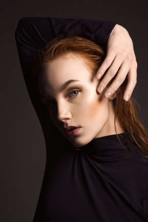 Beautiful girl with wet red Hair. beauty fashion woman portrait
