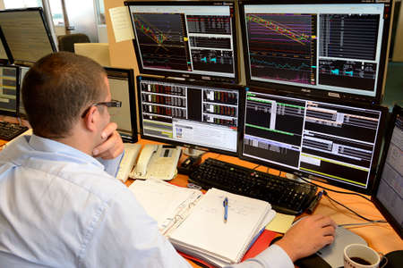 Rouen, Normandie, France, september 2015. Trading room. Negociation for futures markets. Trader with telephone.Purchase/sale orders. Computers with information of Stock Exchange & Fluctuations in the stock market. Editorial