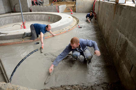 Normandy, France, may 2013. Construction of an automatic milking rotary by three brothers farmers associated, Concreting works