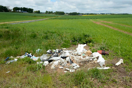 Normandy, France, September 2014. Unauthorized dump in a field