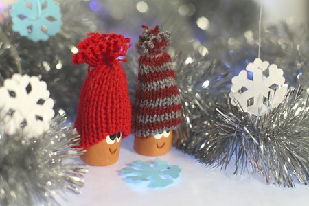 Two happy gnomes in new year tinsel and paper snowflakes Stock Photo