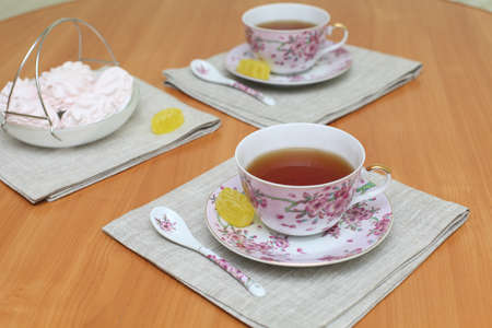 Romantic tea served in beautiful cups with marshmallow photo