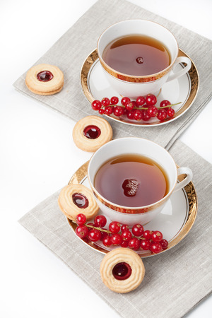 Tea served for two people on linen napkin on white background Stock Photo - 25786628