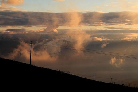 telegraph hill: telegraph poles and pinky morning clouds