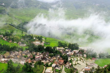 small hillside village after rain in southwest China photo