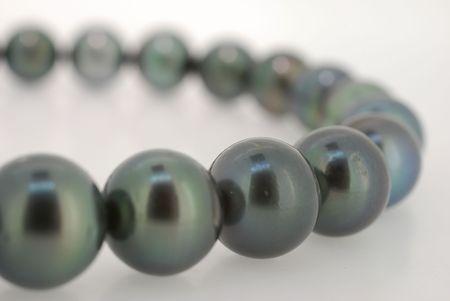 closeup of  dark tahitian pearl strand  photo