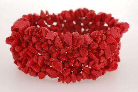 closeup of elastic red coral bracelet photo