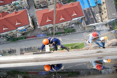 acrophobia: window cleaners cleaning the skyscrapers in the center of Shanghai