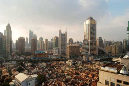 oversea: tall bulidings and modest houses in Shanghai