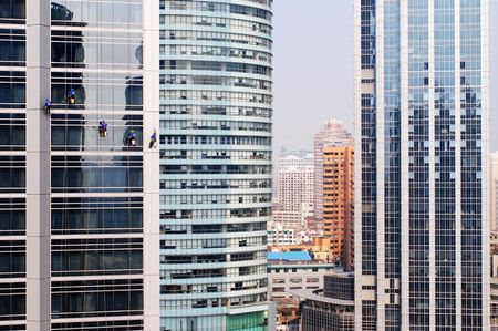 buliding: window cleaners cleaning skyscrapers in the center of Shanghai