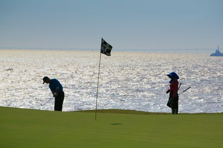 off course: golfer strikes18 Stock Photo