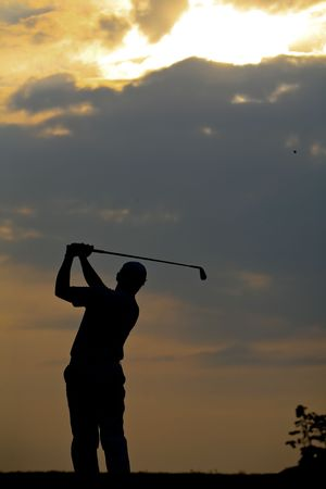 tee off: golfer strikes12 Stock Photo