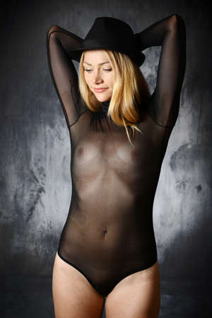 Pretty slim young woman wearing hat and body transparent and see-through as underwear