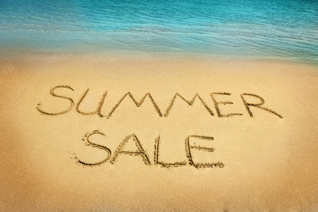 summer sale: Summer sale letters written on the sand beach