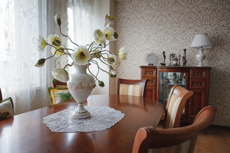 classic interior with light wallpaper and table with chairs