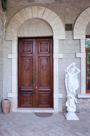 nobel: BAKU, AZERBAIJAN - 17 June, 2015: exterior of the Nobel Villa Petrolea with classic statue and door Editorial