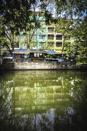 deprived: Riverside slums in Chao Phraya River