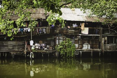underprivileged: Riverside slums in Chao Phraya River