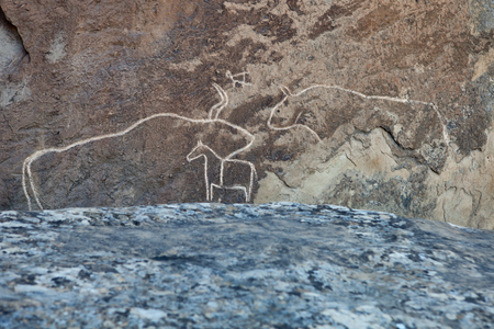 prehistorical: Prehistorical petroglyphs in Qobustan, Azerbaijan. Qobustan petroglyphs are listed by UNESCO as World Heritage.