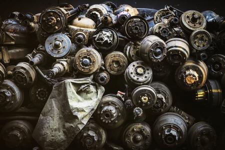 Pile of Rust Old Axles in a Scrap Yard train parts in bangkok