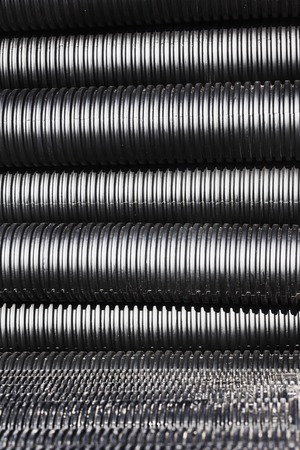 plastic conduit: Close up of black plastic pipes for water with diminishing perspective Stock Photo