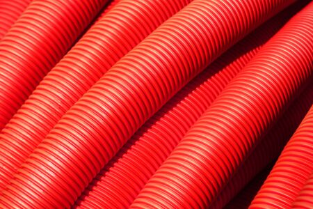 Tubing. Red plumbing pipe plastic pvc close-up. Stock Photo