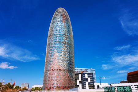 owned: Barcelona, Spain - April 17, 2016: Torre Tower Agbar. This modern building, owned by the multinational group Agbar, was designed by Jean Nouvel.