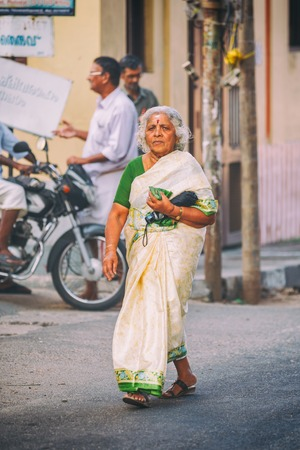 bride bangle: Trivandrum, India - February 17, 2016: old woman in sari walks in the street wearing traditional sari. Saris are wrapped around the body, 4 to 8 metres in length. Editorial